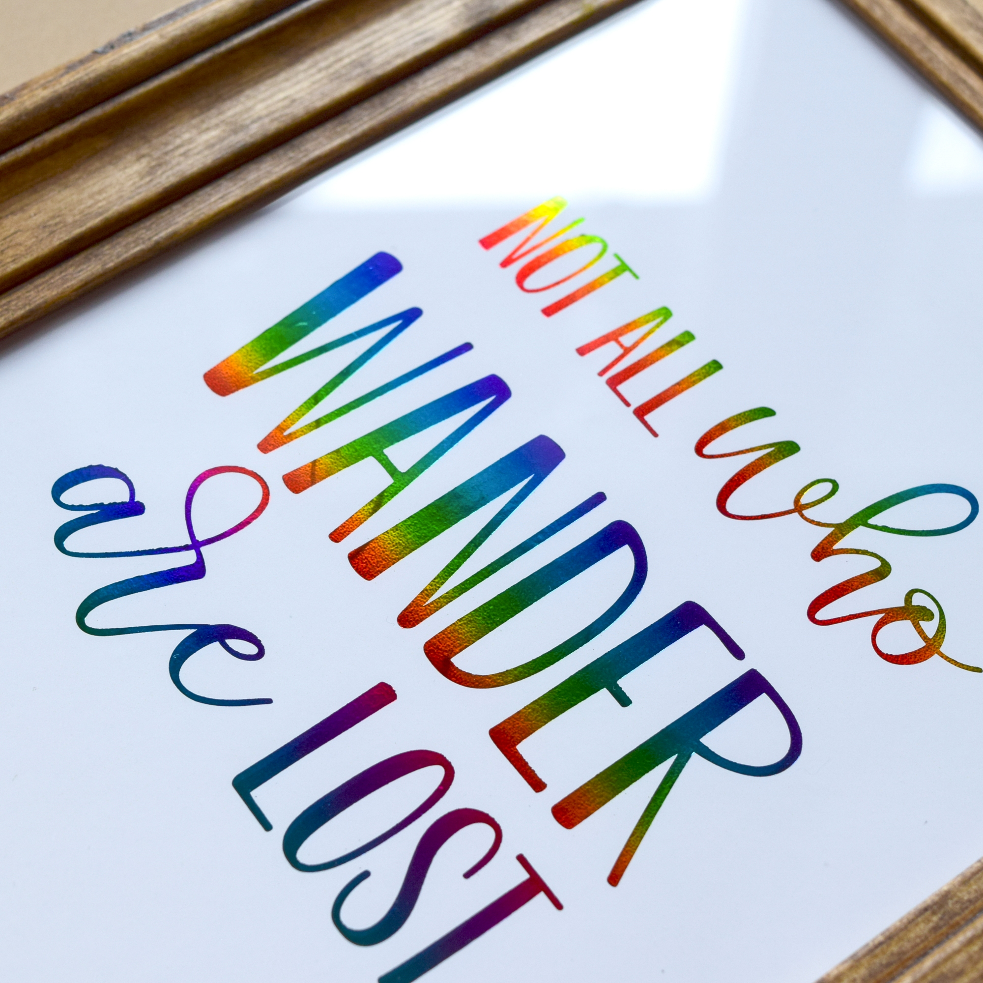 Wall art with decorative rainbow colour foiling